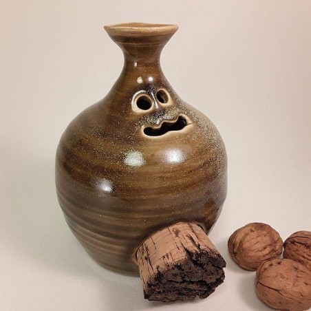 Piggy -phantom- bank with cork navel, left side view