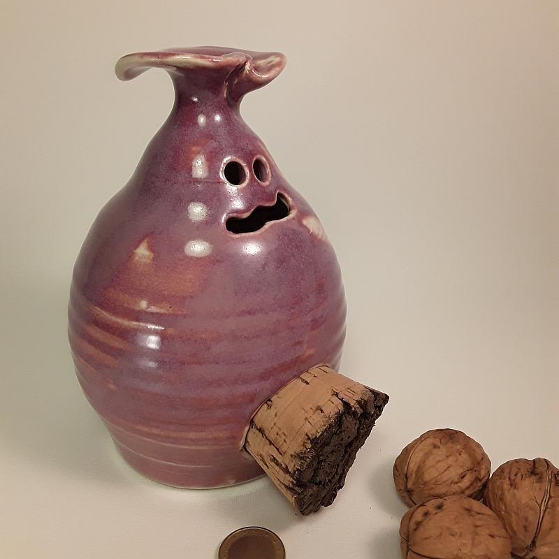 Piggy -phantom- bank with cork navel, left side view