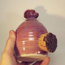 Piggy -phantom- bank with cork navel, down side view