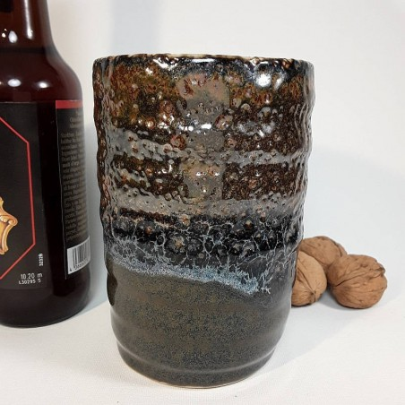Stoneware tumbler, tall glass, left view