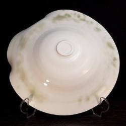 Midsize translucent porcelain dish, down side view