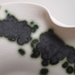 Midsize translucent porcelain dish, glaze detail