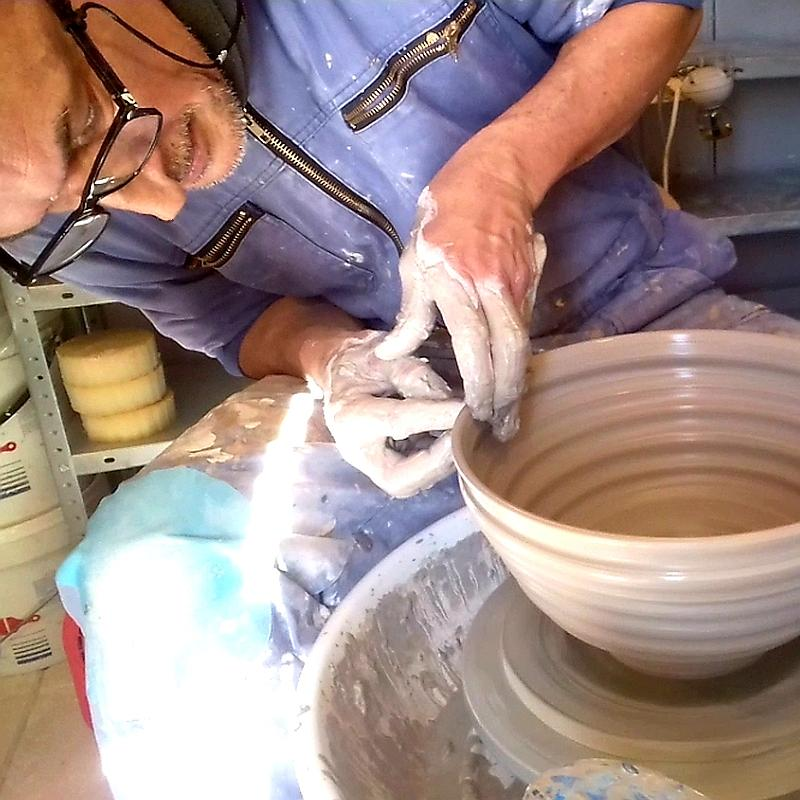 JHMorales throwing a bowl of stoneware